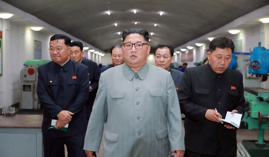 "In this undated photo provided on Saturday, June 1, 2019, by the North Korean government, North Korean leader Kim Jong-un, center, visits the February 8 General Machine Factory in Chagang Province, North Korea. Independent journalists were not given access to cover the event depicted in this image distributed by the North Korean government. The content of this image is as provided and cannot be independently verified. Korean language watermark on image as provided by source reads: ""KCNA"" which is the abbreviation for Korean Central News Agency. (Korean Central News Agency/Korea News Service via AP)"