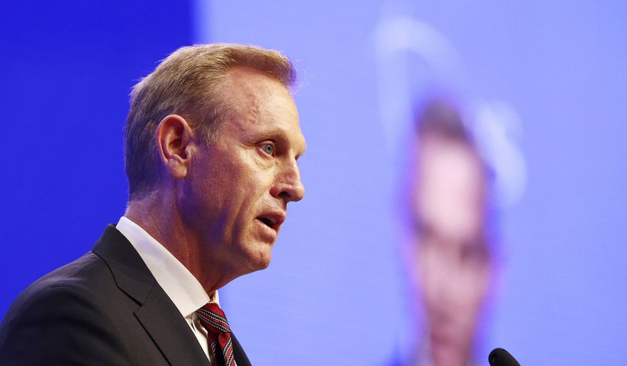 """Acting U.S. Secretary of Defense Patrick Shanahan delivers his speech titled """"The U.S. Vision for Indo-Pacific Security"""" during the first plenary session of the 18th International Institute for Strategic Studies (IISS) Shangri-la Dialogue, an annual defense and security forum in Asia, in Singapore, Saturday, June 1, 2019. (AP Photo/Yong Teck Lim)"""