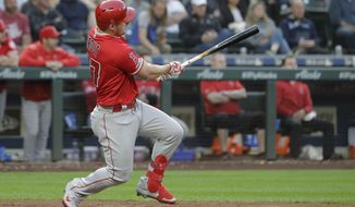 Los Angeles Angels' Mike Trout follows through on a two-run double during the fourth inning of the team's baseball game against the Seattle Mariners, Thursday, May 30, 2019, in Seattle. (AP Photo/Ted S. Warren)