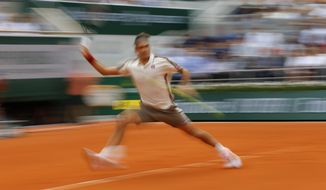 Switzerland's Roger Federer plays a shot against Germany's Oscar Otte during their second round match of the French Open tennis tournament at the Roland Garros stadium in Paris, Wednesday, May 29, 2019. (AP Photo/Michel Euler)