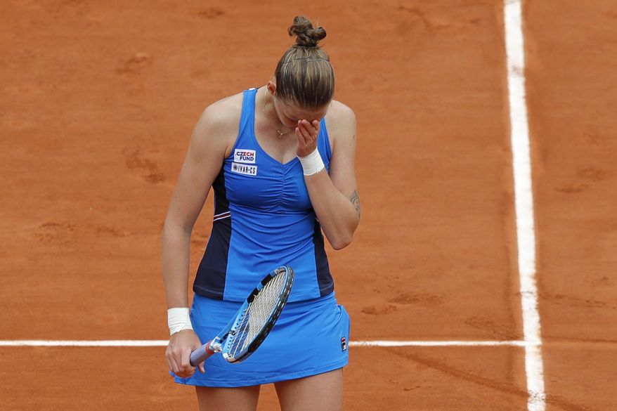 Karolina Pliskova of the Czech Republic reacts after missing a shot against Croatia's Petra Martic during their third round match of the French Open tennis tournament at the Roland Garros stadium in Paris, Friday, May 31, 2019. Martic won in two sets 6-3, 6-3. (AP Photo/Michel Euler)
