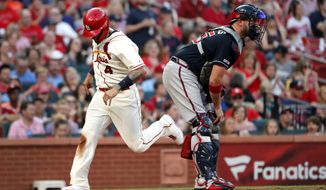 St. Louis Cardinals' Yadier Molina (4) scores past Atlanta Braves catcher Tyler Flowers during the fifth inning of a baseball game Saturday, May 25, 2019, in St. Louis. (AP Photo/Jeff Roberson)