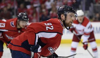 In this April 24, 2019, file photo, Washington Capitals center Evgeny Kuznetsov (92), of Russia, stands on the ice during the second period of Game 7 of an NHL hockey first-round playoff series against the Carolina Hurricanes in Washington. The Capitals say they are aware of a video on social media that appeared to show Kuznetsov in a hotel room with lines of white powder on the table in front of him and verified it is him in the video. In a statement sent to The Associated Press by spokesman Sergey Kocharov, the team says it is in the process of gathering facts and will have no further comment at this time. (AP Photo/Nick Wass) ** FILE **