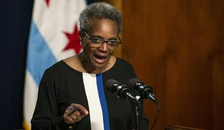 Chicago Mayor Lori Lightfoot holds a press conference at City Hall to address the federal indictment filed against Chicago Alderman Ed Burke and demand he resign immediately, Friday, May 31, 2019, in Chicago. (Ashlee Rezin/Chicago Sun-Times via AP)