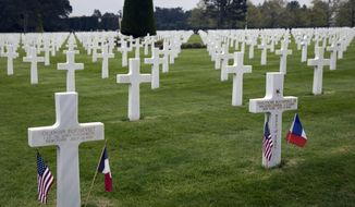 In this Wednesday, May 1, 2019 photo, the headstones of World War II U.S. Brigadier General Theodore Roosevelt Jr, right, and his brother World War I First Lieutenant Quentin Roosevelt, buried side by side at the Normandy American Cemetery in Colleville-sur-Mer, France. President Trump and his French counterpart Emmanuel Macron will next week honor the dwindling number of veterans of the D-Day landing that turned World War II amid plenty of signs the bonds of friendship are under strain. The United States has had a special bond with France throughout its history and especially during two world wars over the past century when even future presidents and sons of presidents risked their lives for the freedom of a friendly nation. (AP Photo/Virginia Mayo)