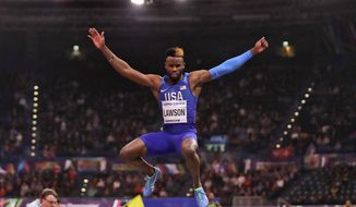 FILE - In this March 2, 2018, file photo, United States' Jarrion Lawson makes an attempt in the men's long jump final at the World Athletics Indoor Championships in Birmingham, Britain. Paul Doyle, the agent for Jarrion Lawson told The Associated Press on Friday, May 31, 2019, that the American long jumper and sprinter is expected to receive a four-year suspension for a failed doping test they maintain is tied to contaminated meat. (AP Photo/Matt Dunham, File)
