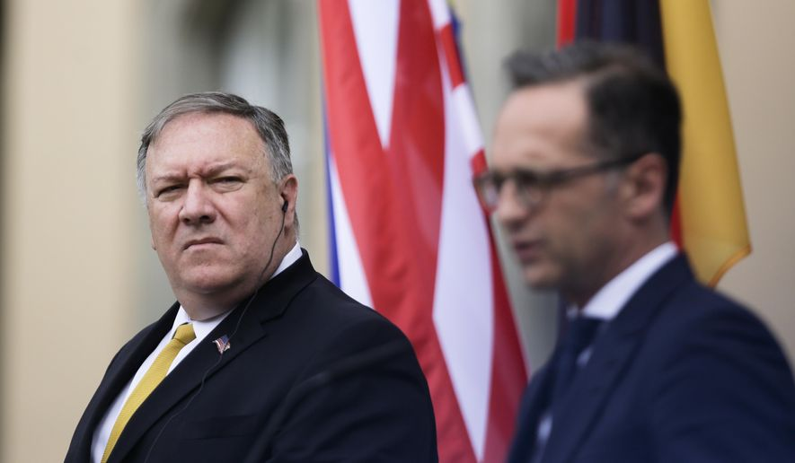 United States Secretary of State Mike Pompeo, left, and German Foreign Minister Heiko Maas, right, brief the media after a meeting at the foreign ministry's guest house Villa Borsig in Berlin, Germany, Friday, May 31, 2019. Mike Pompeo is making his first visit to Germany as secretary of state at the start of a four-nation European trip as tensions rise between the U.S. and Iran. (AP Photo/Markus Schreiber)