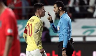 FILE - In this March 26, 2019, file photo, Colombia's James Rodriguez argues with referee Abdulrahman Al Jassim during a friendly soccer match between South Korea and Colombia at Seoul World Cup Stadium in Seoul, South Korea. Abdulrahman Al Jassim, from Qatar which is the host of the 2022 World Cup, was selected as one of the 16 referees for this year's CONCACAF Gold Cup. (AP Photo/Lee Jin-man, File)