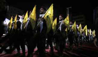 Hezbollah fighters march at a rally to mark Jerusalem day or Al-Quds day, in a southern suburb of Beirut, Lebanon, Friday, May 31, 2019. (AP Photo/Hassan Ammar)