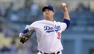 Los Angeles Dodgers starting pitcher Hyun-Jin Ryu, of South Korea, throws during the first inning of the team's baseball game against the New York Mets on Thursday, May 30, 2019, in Los Angeles. (AP Photo/Mark J. Terrill)