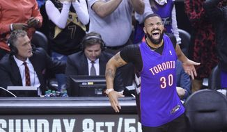 Rapper Drake reacts courtside as the Toronto Raptors play the Golden State Warriors during the first half of Game 1 of basketball's NBA Finals, Thursday, May 30, 2019, in Toronto. (Nathan Denette/The Canadian Press via AP)