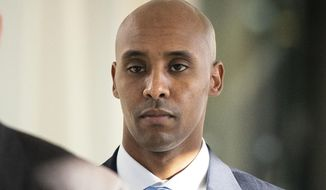 "FILE - In this April 26, 2019, file photo, former Minneapolis police officer Mohamed Noor walks to court in Minneapolis. Attorneys for Noor, convicted of fatally shooting an unarmed woman in 2017, plan to ask a sentencing judge for no prison time. If that's not granted, they're seeking less prison time than state sentencing guidelines recommend. Noor's lawyers filed a motion Thursday, May 30 asking for a ""dispositional departure"" when he is sentenced June 7 for third-degree murder and second-degree manslaughter in the fatal shooting of Justine Ruszczyk Damond who had called 911 to report a possible crime.  (Leila Navidi/Star Tribune via AP, File)"