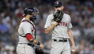 Boston Red Sox starting pitcher Chris Sale, right, talks to catcher Sandy Leon during the fourth inning of the team's baseball game against the New York Yankees, Friday, May 31, 2019, in New York. (AP Photo/Julio Cortez)