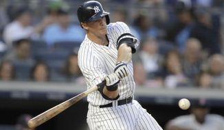 New York Yankees' DJ LeMahieu hits an RBI double off Boston Red Sox starting pitcher Chris Sale during the third inning of a baseball game Friday, May 31, 2019, in New York. (AP Photo/Julio Cortez)