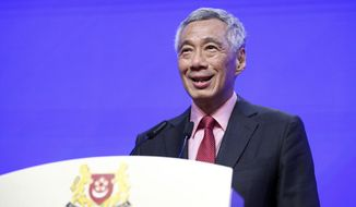 Singaporean Prime Minister Lee Hsien Loong delivers a keynote address during the opening dinner of the 18th International Institute for Strategic Studies (IISS) Shangri-la Dialogue, an annual defense and security forum in Asia, in Singapore, Friday, May 31, 2019. (AP Photo/Yong Teck Lim)