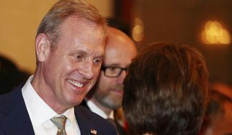 Acting U.S. Secretary of Defense Patrick Shanahan, left, arrives for the opening dinner of the 18th International Institute for Strategic Studies (IISS) Shangri-la Dialogue, an annual defense and security forum in Asia, in Singapore, Friday, May 31, 2019. (AP Photo/Yong Teck Lim)