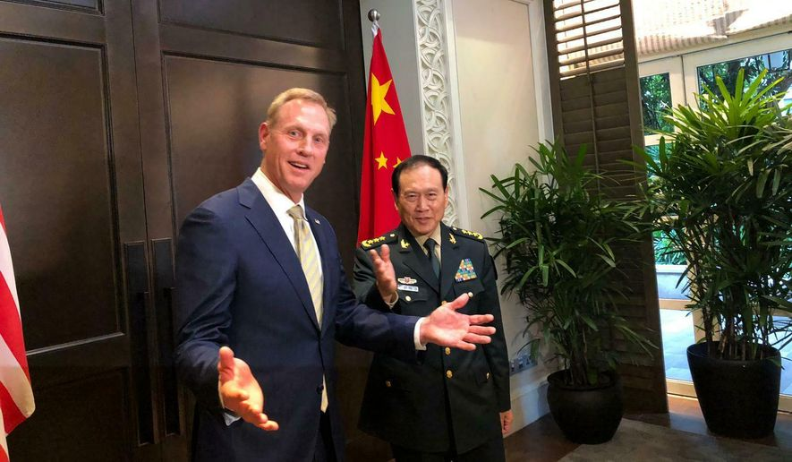 Acting U.S. Secretary of Defense Patrick Shanahan, left, meets with China's Minister of National Defense Wei Fenghe during a meeting on the sidelines of the 18th International Institute for Strategic Studies (IISS) Shangri-la Dialogue, an annual defense and security forum in Asia, in Singapore, Friday, May 31, 2019. (AP Photo/Lolita Baldor)