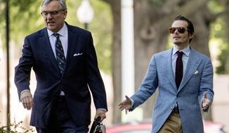 Andrew Miller, a witness who fought testifying to the grand jury in the Roger Stone part of the Russia investigation, right, arrives with his attorney Paul Kamenar, left, at federal court in Washington, Friday, May 31, 2019. (AP Photo/Andrew Harnik)