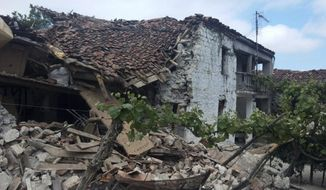 A damaged old house is seen after an earthquake in Floq village about 180 kilometers (110 miles) southeast of Tirana, Albania, Saturday, June 1, 2019. An earthquake with a preliminary magnitude of 5.3 has struck rural areas in Albania southeast of the capital, with a few people reported injured and damaging about 100 houses. (Albanian Defense Ministry via AP)