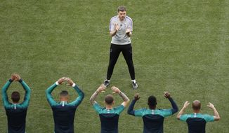Tottenham players stretch during a training session at the Wanda Metropolitano stadium in Madrid, Friday May 31, 2019. English Premier League teams Liverpool and Tottenham Hotspur are preparing for the Champions League final which takes place in Madrid on Saturday night. (AP Photo/Armando Franca)