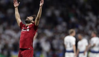 Liverpool's Mohamed Salah celebrates their victory after winning during the Champions League final soccer match between Tottenham Hotspur and Liverpool at the Wanda Metropolitano Stadium in Madrid, Saturday, June 1, 2019. (AP Photo/Manu Fernandez)