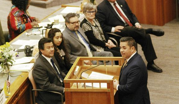 In this Thursday, Jan. 31, 2019, file photo, U.S. Rep. Ben Ray Lujan, of New Mexico, at the podium, addresses the state Legislature in Santa Fe, N.M. (AP Photo/Morgan Lee, File)