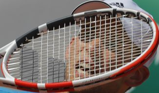 Austria's Dominic Thiem plays a shot against Uruguay's Pablo Cuevas during their third round match of the French Open tennis tournament at the Roland Garros stadium in Paris, Saturday, June 1, 2019. (AP Photo/Michel Euler)