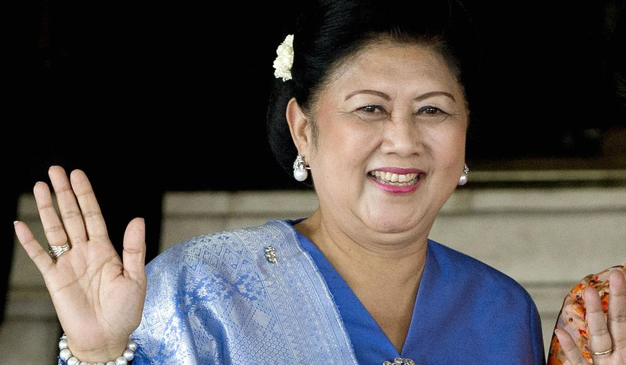 FILE - In this Oct. 20, 2014, file photo, former Indonesian first lady Kristiani Yudhoyono waves at reporters after attending an event at the parliament in Jakarta, Indonesia. Kristiani, the wife of Indonesia's sixth President Susilo Bambang Yudhoyono, has died on Saturday, June 1, 2019, in Singapore where she had been treated for cancer for several months. She was 66. (AP Photo/Mark Baker, File)