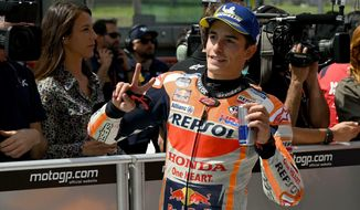Spain's Marc Marquez celebrates after setting the fastest time in the qualifying session for the MotoGP Grand Prix of Italy at the Mugello circuit, in Scarperia, Italy, Saturday, June 1, 2019. (Claudio Giovannini/ANSA via AP)