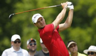 Martin Kaymer, of Germany, tees off on the third hole during the third round of the Memorial golf tournament Saturday, June 1, 2019, in Dublin, Ohio. (AP Photo/Jay LaPrete)