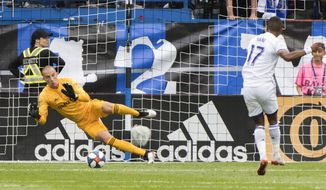 Orlando City's Nani scores on a penalty kick against Montreal Impact goalkeeper Evan Bush during the first half of an MLS soccer match in Montreal, Saturday, June 1, 2019. (Graham Hughes/The Canadian Press via AP)
