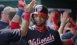 Washington Nationals' Gerardo Parra celebrates in the dugout after hitting a three-run home run off Cincinnati Reds starting pitcher Tanner Roark in the second inning of a baseball game, Saturday, June 1, 2019, in Cincinnati. (AP Photo/John Minchillo) ** FILE **