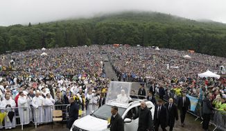 Pope Francis arrives to celebrate Mass at the Marian shrine, in Sumuleu Ciuc, Romania, Saturday, June 1, 2019. Francis began a three-day pilgrimage to Romania on Friday that in many ways is completing the 1999 trip by St. John Paul II that marked the first-ever papal visit to a majority Orthodox country. (AP Photo/Andrew Medichini)