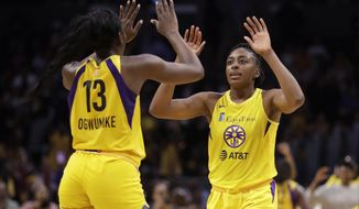 Los Angeles Sparks' Chiney Ogwumike (13) and Nneka Ogwumike celebrate after a win over the Connecticut Sun during a WNBA basketball game Friday, May 31, 2019, in Los Angeles. (AP Photo/Marcio Jose Sanchez)
