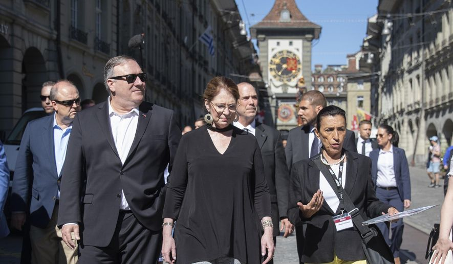U.S. Secretary of State Mike Pompeo, front left, and his wife Suzan, front center, listen to a tourist guide during a sightseeing walk as part of Pompeo's visit in Bern, Switzerland, Saturday, June 1, 2019.(Peter Klaunzer/Keystone via AP)