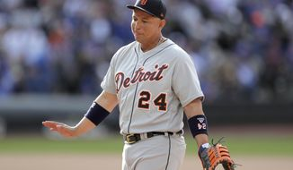 Detroit Tigers first baseman Miguel Cabrera talks to New York Mets players in their dugout during the seventh inning of an interleague baseball game, Saturday, May 25, 2019, in New York. (AP Photo/Julio Cortez)
