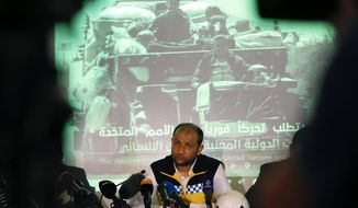 Raed Alsaleh, chairman of the Syrian Civil Defense volunteer rescue group, (White Helmets) talks during a media conference in Istanbul, Friday, May 31, 2019. The group and an alliance of non-governmental organisations have gathered in Istanbul to call attention to an escalation of violence in Idlib province in northwestern Syria. Salah said a catastrophic humanitarian crisis is imminent and the Syrian NGO Alliance appealed to the United Nations Security Council to stop the escalation. (AP Photo/Lefteris Pitarakis)