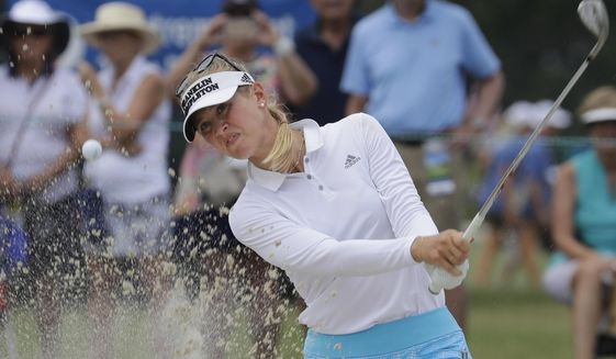 Jessica Korda hits the ball on the ninth hole during the second round of the U.S. Women's Open golf tournament, Friday, May 31, 2019, in Charleston, S.C. (AP Photo/Steve Helber)