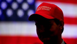 Supporters of President Trump have been giving his campaign an early boost partly by sporting his signature MAGA ball cap. (Associated Press/File)