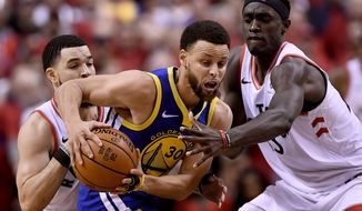 Golden State Warriors guard Stephen Curry (30) tries to fend off Toronto Raptors guard Fred VanVleet (23) and teammate Pascal Siakam (43) during the second half of Game 2 of basketballs NBA Finals, Sunday, June 2, 2019, in Toronto. (Frank Gunn/The Canadian Press via AP)