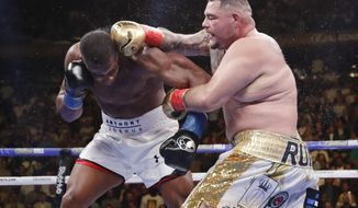 Andy Ruiz, right, punches Anthony Joshua during the seventh round of a heavyweight championship boxing match Saturday, June 1, 2019, in New York. Ruiz won the bout. (AP Photo/Frank Franklin II)