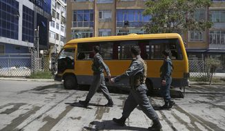 Afghan Security Police arrives at the site of explosions in Kabul, Afghanistan, Sunday, June 2, 2019. Afghan officials say there have been three explosions in the capital, Kabul, including a sticky bomb attached to a bus carrying university students. (AP Photo/Rahmat Gul)