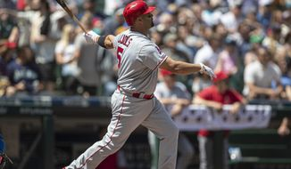 Los Angeles Angels' Albert Pujols hits a three-run home run off of Seattle Mariners starting pitcher Marco Gonzales that also scored Shohei Ohtani and David Fletcher in the second inning of a baseball game, Sunday, June 2, 2019, in Seattle. (AP Photo/Stephen Brashear)