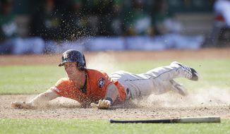 Houston Astros' Myles Straw slides to score against the Oakland Athletics in the 12th inning of a baseball game Sunday, June 2, 2019, in Oakland, Calif. (AP Photo/Ben Margot)