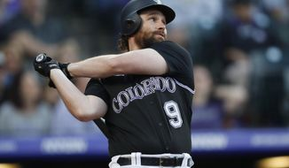 Colorado Rockies' Daniel Murphy follows the flight of his double to drive in two runs off Toronto Blue Jays starting pitcher Marcus Stroman in the first inning of a baseball game Saturday, June 1, 2019, in Denver. (AP Photo/David Zalubowski)
