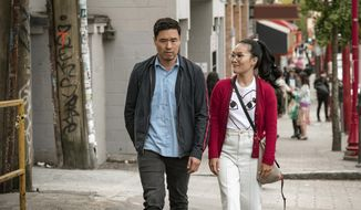 """This undated image shows Randall Park and Ali Wong in a scene from the movie """"Always Be My Maybe."""" The newly released Netflix movie is an Asian-American rom-com with a twist: ethnicity isn't central to the plot. (Courtesy of Netflix)"""