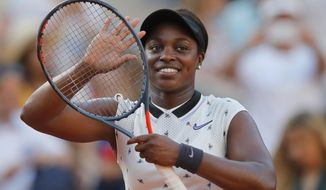 Sloane Stephens of the U.S. celebrates winning her fourth round match of the French Open tennis tournament against Spain's Garbine Muguruza in two sets, 6-4, 6-3, at the Roland Garros stadium in Paris, Sunday, June 2, 2019. (AP Photo/Michel Euler)