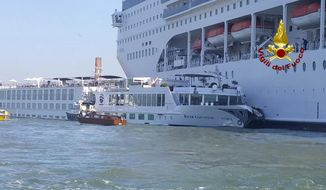 In this photo released by the Italian Firefighters, the MSC Opera cruise liner, a towering cruise ship, strikes a tourist river boat, left,  Sunday, June 2, 2019, in Venice, Italy, injuring at least five people. The collision happened at about 8:30 a.m. on the Giudecca Canal, a major thoroughfare that leads to Saint Mark's Square.  (Vigili del Fuoco via AP)