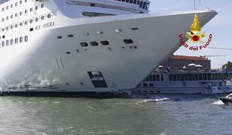 The MSC Opera cruise liner stand by a tourist boat following a collision in Venice, Italy, Sunday, June 2, 2019. A towering cruise ship struck a tourist river boat Sunday morning on a busy canal in Venice, injuring at least five people, Italian media are reporting. The collision happened at about 8:30 a.m. on the Giudecca Canal, a major thoroughfare that leads to Saint Mark's Square. (Vigili del Fuoco via AP)