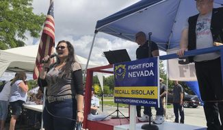 """Radio host Monica Jaye, left, speaks at a rally organized by a group of conservatives preparing to recall Gov. Steve Sisolak in Carson City, Nev., Sunday, June, 2, 2019. The group, called """"Fight for Nevada,"""" claims the new Democratic governor and Democratically-controlled legislature have passed a wave of liberal legislation that infringes on freedom, including gun rights. Nevada lawmakers wrestle over a two-year budget in the final days of the 2019 legislative session. The budget battle centers on whether the state will find enough money to fund salary raises for public school teachers and other education expenses. (AP Photo/Michelle L. Price)"""